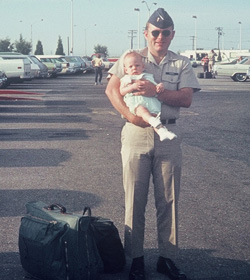 David with daughter in July 1970 departing for Southeast Asia