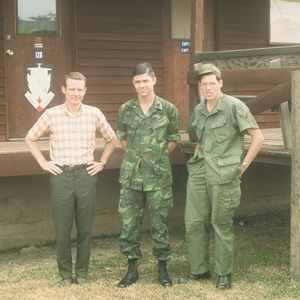 David's roomates, Gary Haws (in civilian clothes) and Roger Witte (center), with another serviceman