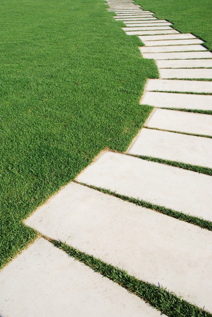 Serpentine pathway stones on a park lawn - Photo by Graphic Stock Images